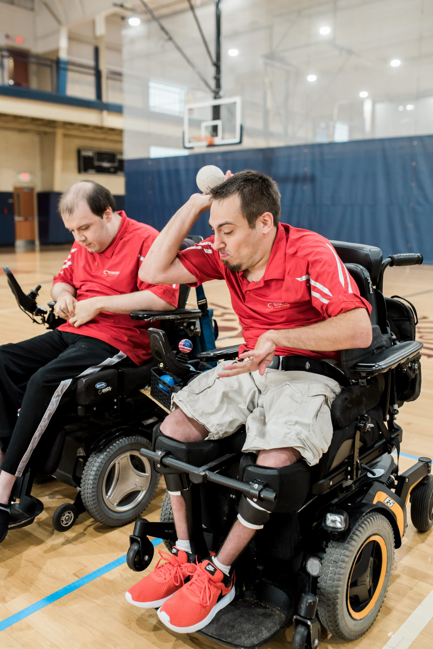 Boccia athlete throwing a boccia ball. Links to programs and services page.