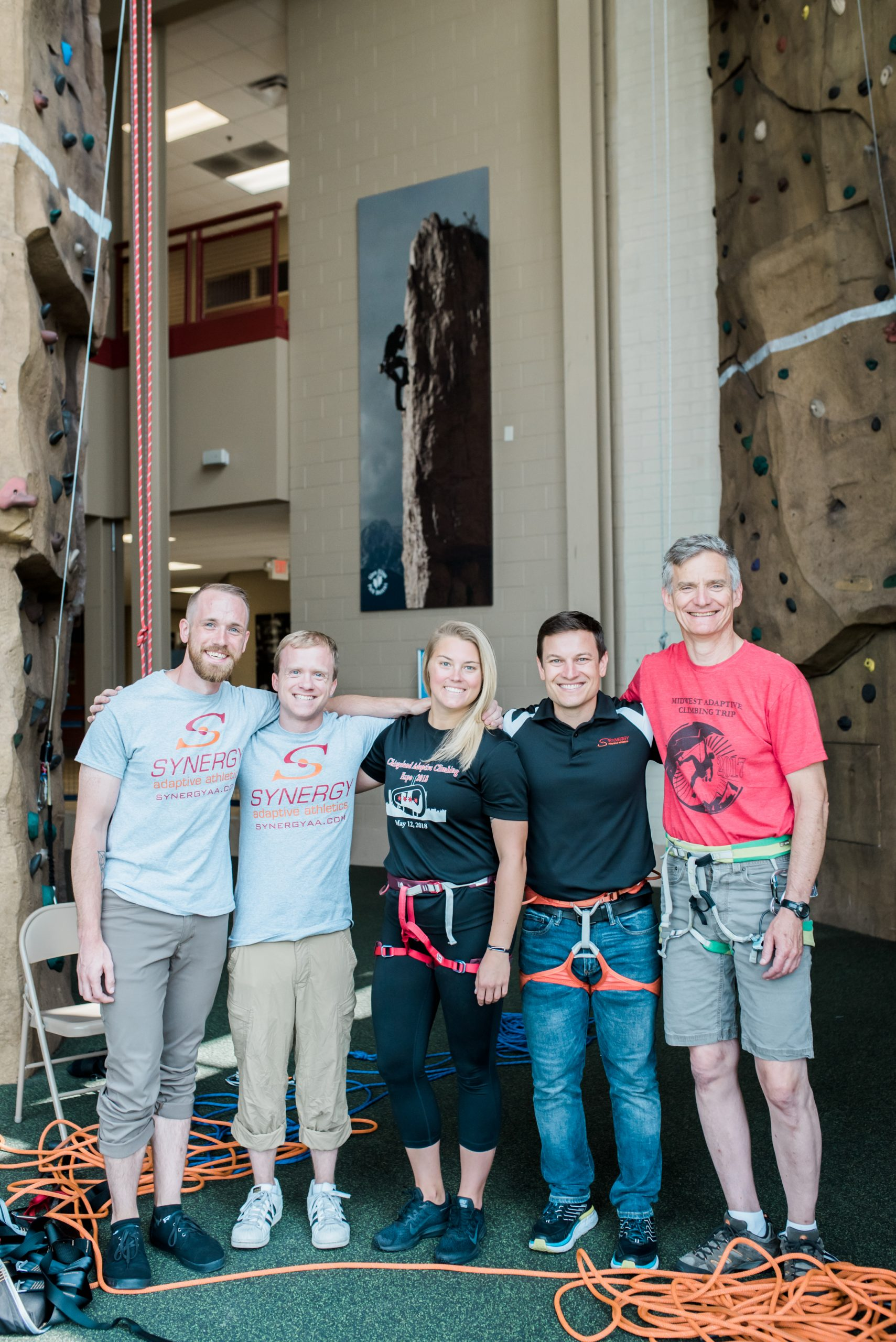 Five climbing staff at climbing wall. Links to volunteer and employment opportunities